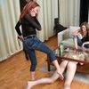 Girls Help Each Other Stimulating Slave With A Whip As He Is Licking Feet