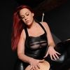 Carol In Leather Dress Receives An Ass Spanking From Lezdom ...